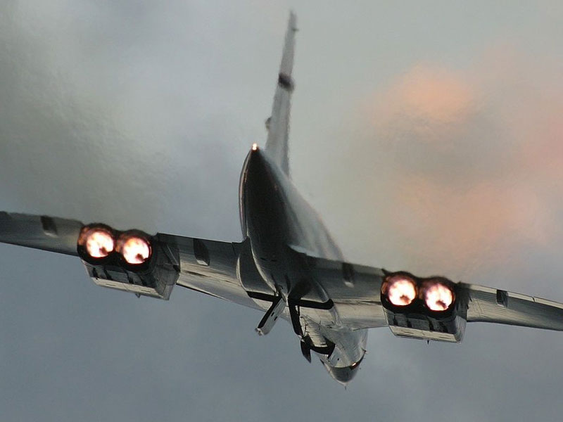 Concorde with its reheat or afterburners fully lit just after take off..